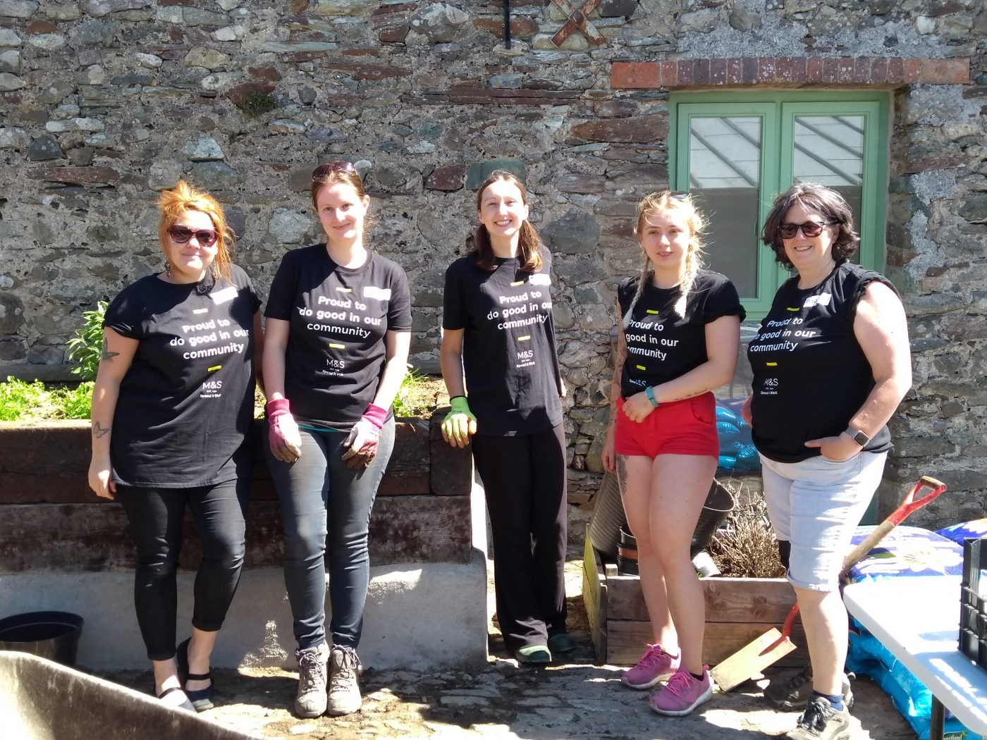 Volunteers from Marks and Spencer transformed a courtyard for visiting children at Lower Treginnis in 2018